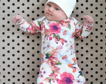 Cream baby hat, with tassel. Choose pink or gray top. 100 percent cotton. Adjustable. (Made by lippy brand) Unisex, neutral beanie boy girl