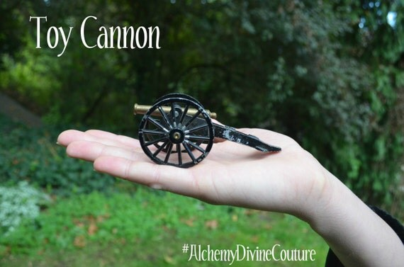 Toy Cannon, 1940s metal cannon toy, marked Japan. from Alchemy Divine