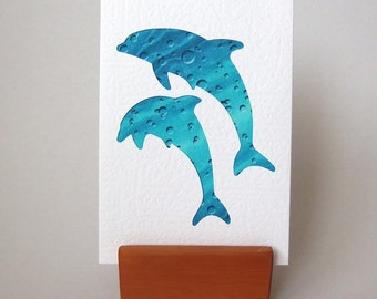 """DOLPHINS Greeting Card  -  6"""" x 4"""" with envelope. Blank Fabric Card. Porpoises on aqua fabric , Textured white card."""