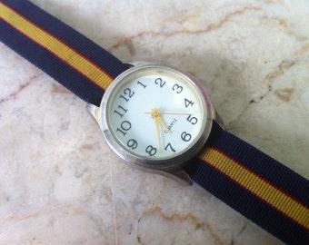 Vintage Watch, Silver Color Case, Round Bezel, white dial, Quartz, gold color hands, black numbers,  vintage nylon band, GEN608, 27 x 33 mm