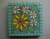 "Made to Order, exterior mosaic stepping stone, 12"" x 12"", daisies and sunflower with jade-colored background tile"