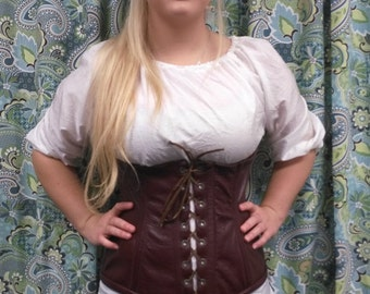 Lined and boned leather longwaisted corset.