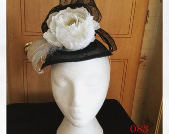 Beautiful Black and White Fascinator with a White Flower
