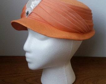 1950's tangerine colored cloche hat. Leslie Monroe.