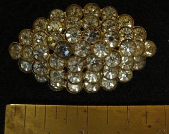 Czechoslovakia gold tone rhinestone tiered elliptical brooch