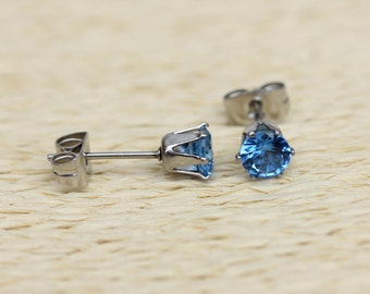 Genuine London Blue Topaz and Surgical steel stud earrings in either 3mm, 4mm, 5mm or 6mm sizes!