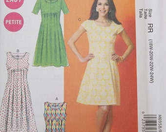 McCall's M6958. Size 18W-24W. Beautiful and simple-to-sew dress pattern. Perfect for many different occasions. Uncut and factory folded.