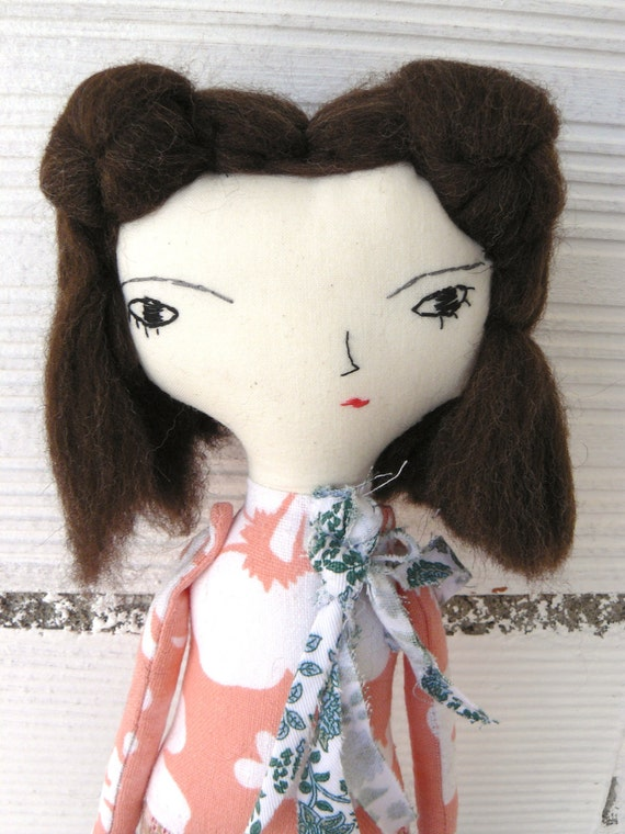 Rag doll on cotton canvas. Pure wool hair. Hand embroidered