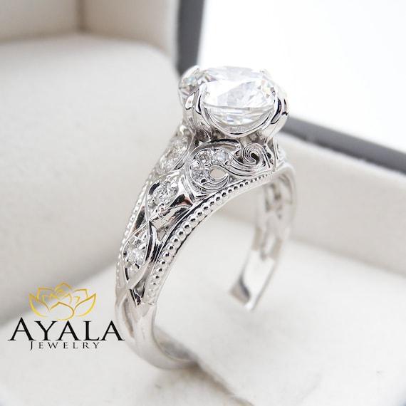unique moissanite engagement ring in 14k white gold filigree