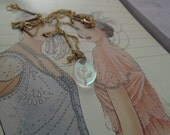 """vintage tiny glass oval pendant with thistle engrave shows right through on 18""""long chain"""