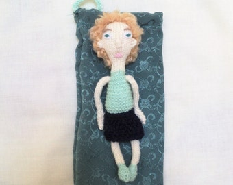 Hand Knitted Doll Wearing a Green and Blue Dress