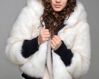 Polar she-wolf. Winter faux fur coat
