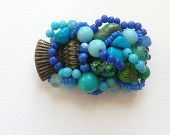 Turquoise green assemblage brooch thistle OOAK vintage beads
