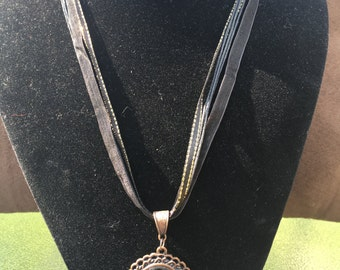 Black Ribbon Necklace with Brass Pendant