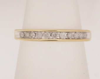 0.25 Carat T.W. Ladies Round Cut Diamond Band 10K Yellow Gold Ring