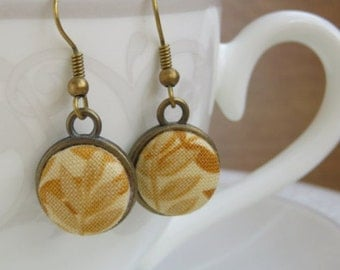 Drop earrings in antique bronze and Ochre yellow fabric