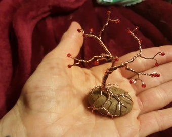 Miniature Tree of Life with red flowers