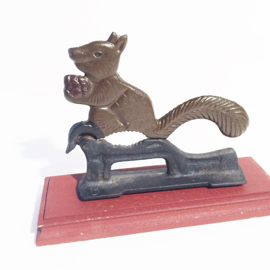 Squirrel nut cracker cast iron body on wooden platform - Squirrel nut crackers ...