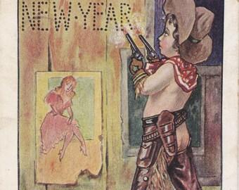 Shoot Em Up Cowboy- 1900s Antique Postcard- Happy New Year- Guns for Christmas- Ullman Mfg- Assless Chaps- Art Comic- Paper Ephemera- Used