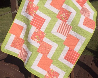 "Peach/Orange, Spring Green and White Altogether In This 36"" X 44.5"" Falling Charms Quilt"