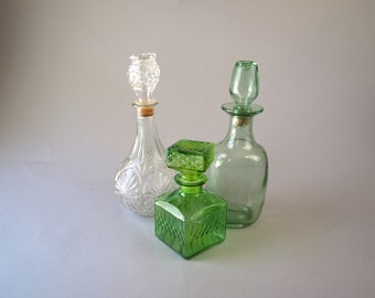 Set of 3 vintage glass decanters clear green whiskey bourbon booze bottles with toppers mid century madmen gift