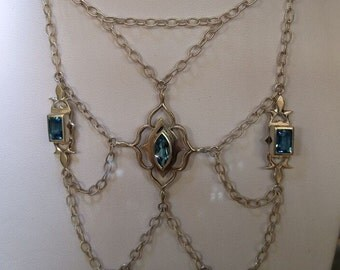 Silver necklace with hand-carved detail and four topaz stones
