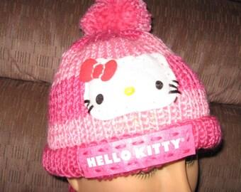 Hello Kitty inspired hand knit children's hat in dark and light pink stripes