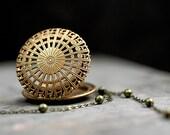 Vintage filigree locket necklace with ballchain. Vintage brass locket with long necklace.
