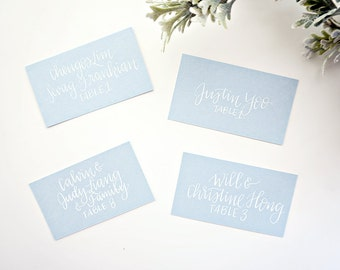 white calligraphy handwritten escort cards // custom for place cards