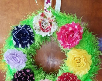 10 inch fun fur covered wreath with silk flower accents