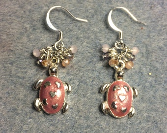 Mauve enamel turtle charm dangle earrings adorned with tiny dangling pink and lavender Chinese crystal beads.