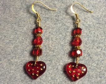 Red Czech glass heart bead dangle earrings adorned with red Czech glass beads.