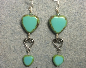 Large and small matching opaque turquouse Czech glass heart bead earrings joined by a silver Tierracast heart connector charm.