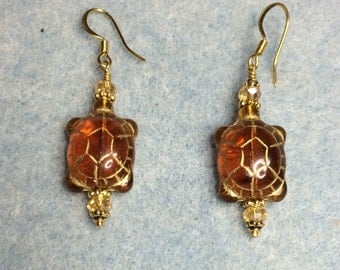 Topaz Czech glass turtle bead earrings adorned with topaz crystal beads.