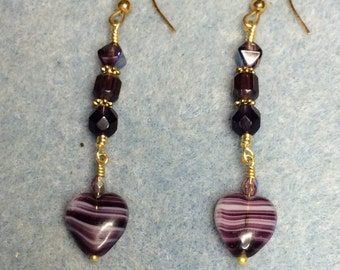 Purple vintage heart dangle earrings adorned with purple Czech glass beads.