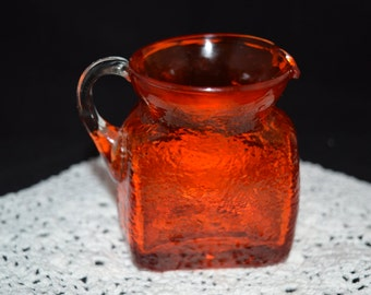 Orange glass pitcher / small creamer / small pitcher / blown glass / orange / creamer / pitcher / vintage glass / orange glass / decorative