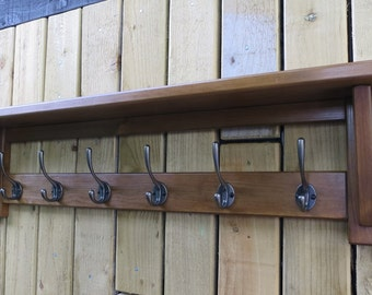 6 Hook rustic wooden hat and coat rack with shelf.