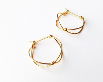 Small gold plated hoop earrings. Offered delivery.