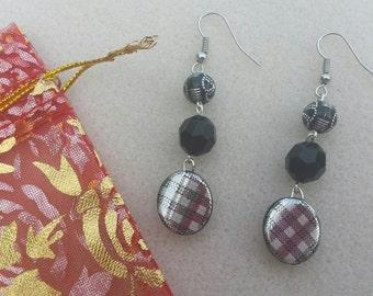 Black patterned drop ear rings by L.dot