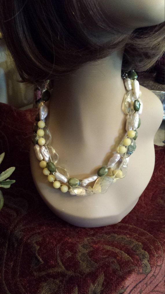 Three strand necklace made with assorted semi precious stones