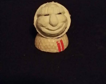 Jose. Hand carved golf ball by Big John