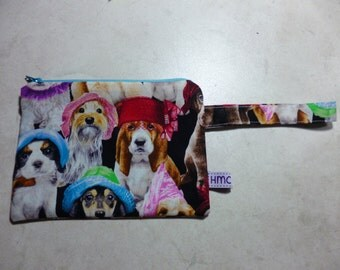 Small zippered bag.  Pups in hats print. 18cm x 13cm. Fully lined and washable.