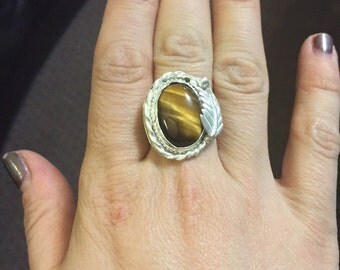 Handmade silver ring with Tigers Eye Cabochon stone.  Size 8