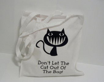 Don't let the cat out of the bag tote shopper bag.