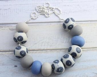 """Bead """"Caroline"""" necklace. Cornflower blue grey pearl white swirl patttern polymer clay beads by Smitten Kitten."""