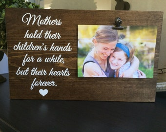 Mothers hold their children's hands for a while, but their hearts forever.   Geat for a Mother's Day Gift