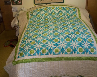 Hand quilted Turquoise & Lime green Storm at Sea quilt; bleached sand borders