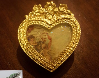 Golden heart brooch