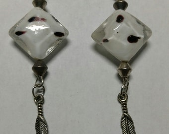 Black and white bead earring with feather