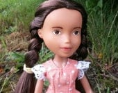 Repainted bratz doll  with a hand made dress and 2nd outfit of original Bratz clothing.
